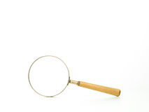 A magnifying glass with wooden handle Royalty Free Stock Image