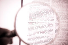 A magnifying glass on the word achievement Stock Photography