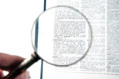 A magnifying glass on the word achievement Stock Images