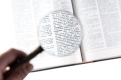 A magnifying glass on the word computer Stock Photography
