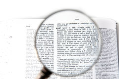 A magnifying glass on the word goal Stock Photos