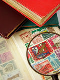 Magnifying glass and world postage stamps Stock Images