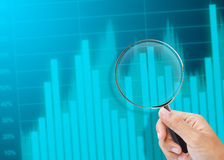 Magnifying glass zoom on a business chart. Magnifying glass zoom on business chart Stock Image