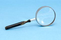 Magnifying glass zoom retro tool blue background Stock Photography