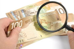 Magnifying Glasses With Canadian Dollar Stock Images