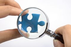 Magnifying Jigsaw Puzzle Stock Photos