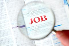 Magnifying job word Stock Photo