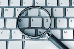 Magnifying on a keyboard Royalty Free Stock Photography