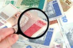 Magnifying latvian money Royalty Free Stock Photos