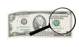 Magnifying lens changes dollar bill Stock Image