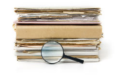 Magnifying lens on the old files background Stock Photo