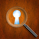 Magnifying optical glass with Keyhole. And bright sun in the sky royalty free stock photo