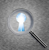 Magnifying optical glass with Keyhole Royalty Free Stock Photo