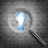 Magnifying optical glass with Keyhole and bright sun in the sky Royalty Free Stock Images