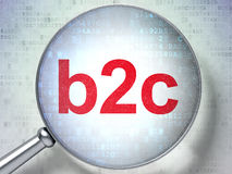 Magnifying optical glass with words b2c on digital Stock Image