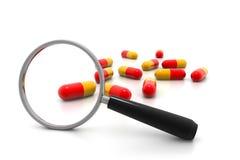 Magnifying pills Stock Photos
