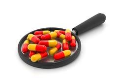 Magnifying pills Royalty Free Stock Photos