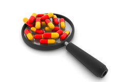 Magnifying pills Royalty Free Stock Photography