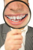Magnifying smile stock image