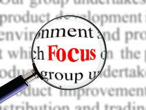 Magnifying on word focus Royalty Free Stock Photos