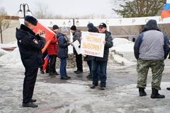 Magnitogorsk, Russia, - March, 10, 2019. Protest meeting for free Internet. A policeman takes pictures of one of the participants
