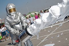 Magnitogorsk, Russia, - August, 7, 2014. A fireman in a protective suit extinguishes a fire using foam mixture in the town square. Training sessions. Caption royalty free stock photo