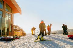 group of snowboarders and skiers prepare to descend on mountain Royalty Free Stock Photo