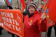 "Magnitogorsk, Russia, - May, 1, 2019. An elderly woman is an oppositionist; a participant in the May Day demonstration carries a. Poster with the words "" stock images"