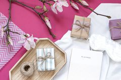 Magnolia flower flat lay morning in bed concept composition. royalty free stock photography