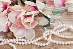 Magnolia flowers with pearls Royalty Free Stock Images