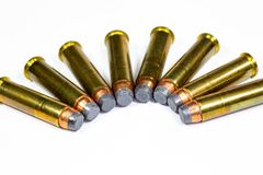 357 Magnum bullets laying on a white counter. 357 Magnum bullets laying in a circular pattern on a white counter stock image