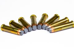 357 Magnum bullets laying on a white counter. 357 Magnum bullets laying in a circular pattern on a white counter royalty free stock photography