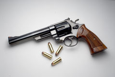 Magnum revolver. With bullets on white Royalty Free Stock Image