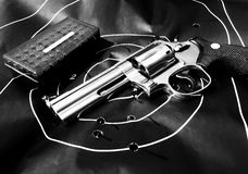 .357 Magnum revolver handgun. Ammunition and human silhouette shooting target royalty free stock photos
