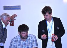 Magnus Carlsen and his team. Rapid and Blitz Chess World Champion Grand Master  Carlsen Magnus shortly after winning the Rapid chess world champion title Royalty Free Stock Photography
