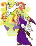 Mago que conjura un unicornio. Fotos de archivo
