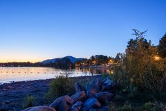 Magog, Province of Quebec, Canada, September 2018. Beautiful Mag. Og town at night in reflections of Memphremagog lake. Canadian romantic landscape with stock photo