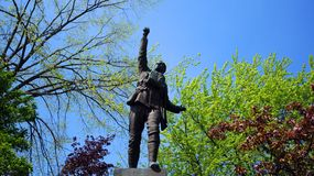 A war memorial statue in Magog. MAGOG QUEBEC CANADA 08 12 2016: A war memorial statue in Magog, Eastern Townships, Quebec, Canada stock photography
