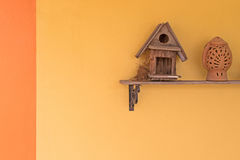 Magpie robin bird build up its nest inside wooden bird house on Royalty Free Stock Photography