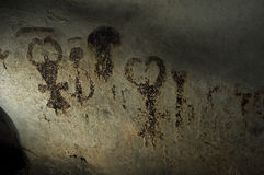 Magura cave in Bulgaria. Prehistoric paintings on rock. Rock paintings of prehistoric people made with manure bat. Cave in which people lived in ancient times royalty free stock photography