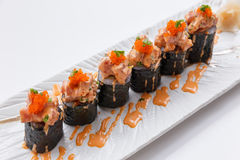 Maguro Maki Sushi Topping with Maguro Bluefin Tuna with Sauce and Ebiko Shrimp Egg Served with Wasabi and Prickled Ginger.  Stock Photography