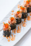 Maguro Maki Sushi Topping with Maguro Bluefin Tuna with Sauce and Ebiko Shrimp Egg Served with Wasabi and Prickled Ginger.  Royalty Free Stock Image