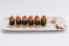 Maguro Maki Sushi Topping with Maguro Bluefin Tuna with Sauce and Ebiko Shrimp Egg Served with Wasabi and Prickled Ginger Stock Photo