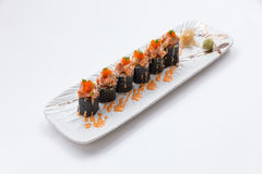 Maguro Maki Sushi Topping with Maguro Bluefin Tuna with Sauce and Ebiko Shrimp Egg Served with Wasabi and Prickled Ginger.  Stock Photo