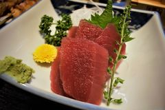Maguro Sashimi with Sake at an Izakaya, Tokyo, Japan royalty free stock photo