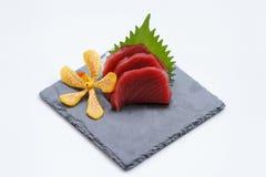Maguro Sashimi : Sliced Raw Maguro Tuna Served with Sliced Radish on Stone Plate.  Stock Image