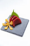 Maguro Sashimi : Sliced Raw Maguro Tuna Served with Sliced Radish on Stone Plate Royalty Free Stock Photography