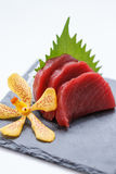Maguro Sashimi : Sliced Raw Maguro Tuna Served with Sliced Radish on Stone Plate.  Royalty Free Stock Images
