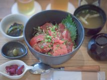 Magurodon, the famous japanese red tuna bowl. Composed by raw red tuna fish slices and japanese rice, it`s a lunch menu with miso soup and japanese pickles Stock Photo