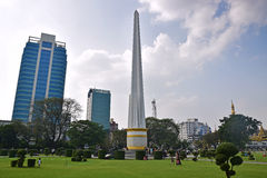 Maha Bandoola Garden with its popular landmark of tall Independence Monument tower in the middle. Maha Bandoola Garden, located in downtown Yangon, Burma with stock images